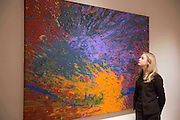 "UNITED KINGDOM, London: 1 February 2016 A Bonham's staff member takes a close look at Shozo Shimamoto's ""Magi 903"" (estimated to be worth £60,000 - 80,000) which forms part of the Post-War Contemporary Art Sale which opens 11th of February 2016. Other work includes Andy Warhol's ""Fourteen Small Electric Chairs"" estimated to be worth £4,000,000 - 6,000,000. Rick Findler  / Story Picture Agency"