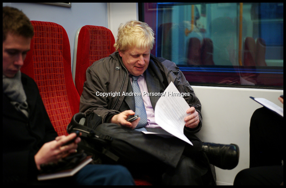 London Mayor Boris Johnson on the train at Waterloo Station on his way to Campaign in Feltham, West London, for the By-Election with Mark Bowen the Conservative Party Candidate, Tuesday December 13, 2011 Photo By Andrew Parsons/ i-Images
