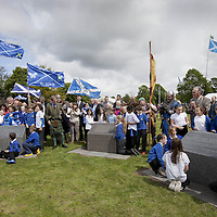 THe Earl of Moray, pictured between the plinths on the left is Andrew de Moray&rsquo;s direct descendent and unveils the lecterns with the help of the local children from St Ninians Primary School.<br /> <br /> BRAVEHEART HEROES, WILLIAM WALLACE AND ANDREW DE MORAY, FINALLY HONOURED AT STIRLING BRIDGE BATTLE SITE AS SALTIRE RAISED FOR FIRST TIME IN OVER 700 YEARS<br /> <br /> Friday 29th May, 2015<br /> <br /> IT&rsquo;S TAKEN more than 700 years but today, the two heroes at the centre of one of the most important battles in Scottish history have been jointly honoured at the spot where they both led an outnumbered Scottish army to victory against the English.<br /> The formal unveiling ceremony at Stirling Bridge today (Friday 29th May), of three lecterns made of traditional Scottish whinstone dedicated to the memory of William Wallace and Andrew de Moray,&nbsp;at site of the historic victory at Battle of Stirling Bridge.<br /> At a special ceremony attended by Andrew de Moray&rsquo;s direct descendant, the Earl of Moray, and Stewart Maxwell, MSP, convener of the Scottish Parliament&rsquo;s Education and Culture Committee, the memorials were formally unveiled.Mr Maxwell opened the event and after the dedication, together with the Earl of Moray, they raised the Saltire together at the site of the Battle of Stirling Bridge. This is the first time in over 700 years that the Saltire has flown at Stirling Bridge. The flag will now become a permanent fixture at the site of the Battle.<br /> John Stuart, the current Earl of Moray, said of his illustrious kinsman: &ldquo;I am delighted that Andrew de Moray is finally, after 700 years, to have the recognition he deserves. The Guardians of Scotland have put a huge amount of time and effort into the lecterns, which are a very fitting tribute to one of Scotland's greatest patriots.&quot;<br /> The victory represented a key moment in the Scottish Wars of Independence. Eminent Scots historian, Sir Tom Devine, recently described the battle as being &lsquo;second in importance only to Bannockburn in the Wars of Independenc