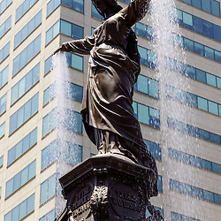 Photo of Cincinnati fountain named The Genius of Water by Tyler Davidson. Located in Fountain Square in downtown Cincinnati, Ohio, the statue is one of the city's most popular attractions. Image is vertical, high resolution and was taken in 2012.
