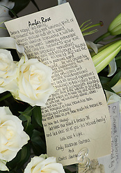 © London News Pictures. 05/11/2014. A note left on flowers by Carlos Santana. The funeral Jack Bruce at Golders Green Crematorium in North London. Jack Bruce was the lead singer and bass player for British Rock band Creme, alongside Eric Clapton and Ginger Baker. Creme sold over 15 million albums worldwide and were widely considered to be the worlds first successful supergroup. Photo credit : Ben Cawthra/LNP