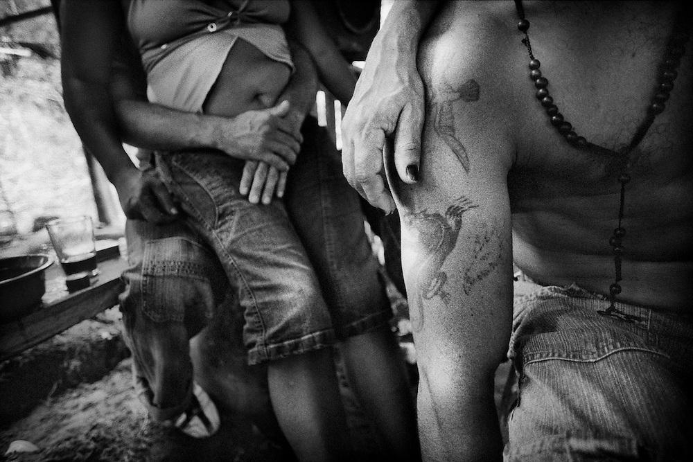 Brazil, Amazonas, Eldorado do Juma.<br /> <br /> Grota rica, cabaret (bordel).<br /> Eldorado do Juma est maintenant un bidonville de plastique noir et de misere croissante sur la rive du fleuve, qui attire les prospecteurs. Des centaines d'hommes y creusent la boue sur leurs petites parcelles delimitees par des branchages et des ficelles. A la fin du jour, les plus chanceux auront trouve quelques poussieres d'or, vendues ensuite 40 reals le gramme (14,5 euros) a Apui, 65km au nord. Les plus riches du coin sont ceux et celles qui cuisinent, nettoient ou divertissent les mineurs.