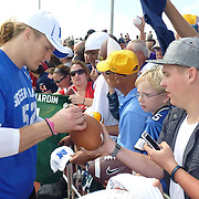Green Bay Packer Pro Bowler, and former USC Trojan Clay Mathews, greets and autographs for military packer fans at Hickam Air Base immediately after the NFC practice.  Photo by Barry Markowitz, 1/26/12