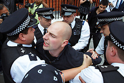 © Licensed to London News Pictures.  16/08/2012. LONDON, UK. Police arrest an activist outside the Ecuador Embassy in London. A decision regarding wikileaks founder Julian Assange application for asylum is expected later today. Photo credit :  Cliff Hide/LNP