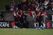Peru defender Luis Abrahm (2) celebrates with forward Andre Carrillo (18), midfielder Christofer Gonzales (16) and midfeidler Christian Cueva (10) after scoring a goal against Brazil in the second half during an international friendly soccer match, Tuesday, Sept. 10, 2019, in Los Angeles. Peru defeated Brazil 1-0.
