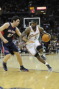 Cleveland Cavaliers forward LeBron James drives, right, drives past Atlanta Hawks center Zaza Pachulia during the first quarter in a NBA basketball game Friday, April 2, 2010 in Cleveland,Ohio (AP Photo/Jason Miller)