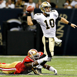 August 12, 2011; New Orleans, LA, USA; New Orleans Saints quarterback Chase Daniel (10) is pressured by San Francisco 49ers defensive tackle Demarcus Dobbs (78) during the second half of a preseason game at the Louisiana Superdome. The New Orleans Saints defeated the San Francisco 49ers Mandatory Credit: Derick E. Hingle