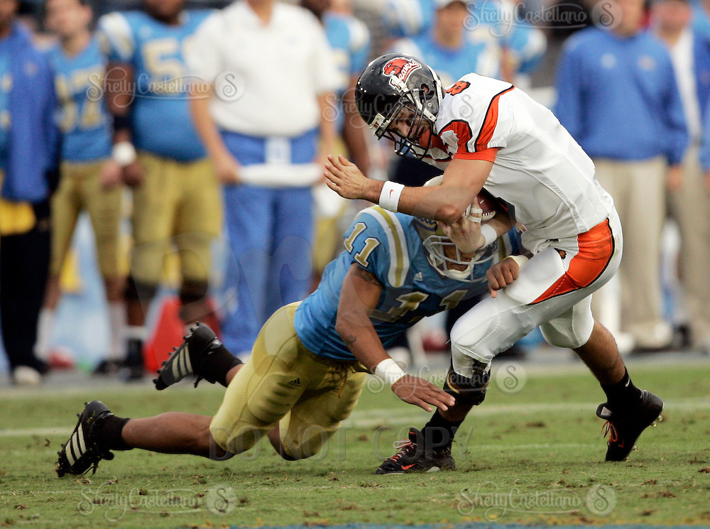 11 November 2006:  #11 Dennis Keys sacks with a hard hit on the legs QB #8 Matt Moore during the UCLA Bruins 25-7 win over the Oregon State Beavers Pac-10 college football game at the Rose Bowl.<br />