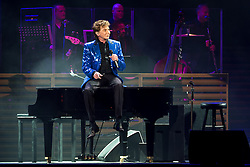 © Licensed to London News Pictures . 18/05/2014 . Phones4U Arena, Manchester , UK . Barry sits on the piano . Barry Manilow performs at the Phones4U Arena in Manchester . Photo credit : Joel Goodman/LNP