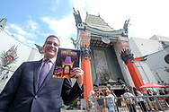 Los Angeles Mayor Eric Garcetti shows the first commemorative, full-color souvenir book to mark the 90-year history of the TCL Chinese Theatre, on Monday, July 24, 2017, in Los Angeles  (Photo by Ringo Chiu)<br /> <br /> Usage Notes: This content is intended for editorial use only. For other uses, additional clearances may be required.