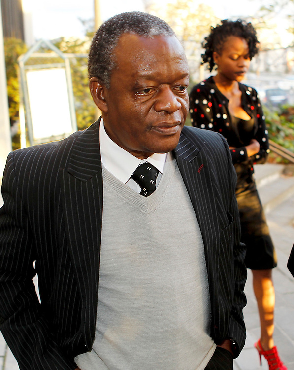 George Gwaze who is charged with violating and murdering 10-year-old Charlene Makaza, leaves the High Court Christchurch, New Zealand, Monday, May 28, 2012. Credit:SNPA / Martin Hunter