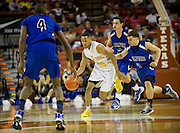 Jeremiah Jefferson (15) of Dallas Triple A Academy dries past the Mumford defense during the UIL 1A division 1 state championship game at the Frank Erwin Center in Austin on Friday, March 8, 2013. (Cooper Neill/The Dallas Morning News)