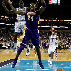 April 24, 2011; New Orleans, LA, USA; New Orleans Hornets point guard Chris Paul (3) knocks the ball away from Los Angeles Lakers shooting guard Kobe Bryant (24) during the third quarter in game four of the first round of the 2011 NBA playoffs at the New Orleans Arena. The Hornets defeated the Lakers 93-88.   Mandatory Credit: Derick E. Hingle