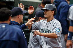 OAKLAND, CA - MAY 04: Norichika Aoki #8 of the Seattle Mariners is congratulated by teammates in the dugout after scoring a run against the Oakland Athletics during the fifth inning at the Oakland Coliseum on May 4, 2016 in Oakland, California. (Photo by Jason O. Watson/Getty Images) *** Local Caption *** Norichika Aoki