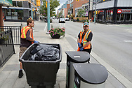 """CANADA, Kitchener. Sean (beard and hat) and Cornelius work together on Clean Team II or the """"garbage"""" team. Sean finds himself as a superivisor becasue he knows where the garbage drop off sites are. cornelius is just new into Kitchner after moving from Hamilton. Job Cafe Projects, part of The Working Centre, are designed to encourage people to particpate in informal and useful jobs. Two new projects are Discovery Team and Clean Team II. Clean Team I, another component, has been in operation for several years."""