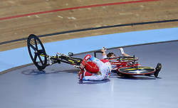 Evgenia Augustines of Russia and Daria Pikulik of Poland after colliding during the Women's Madison Final during day three of the Tissot UCI Track Cycling World Cup at Lee Valley VeloPark, London.