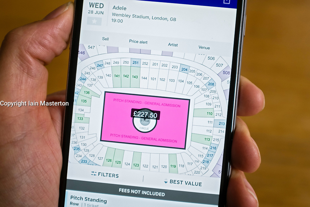 Stubhub online ticket selling website showing seating plan and prices for Adele concert on smart phone screen.