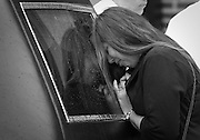 Lauren Calvillo's mother Ollie Hubbard grieves at the back of a hearse carrying her daughter outside her funeral at All Saints Parish in Hammond.