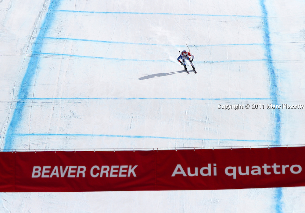 SHOT 12/2/11 1:04:22 PM - Swiss skiier Marc Gisin makes his way towards the finish line during the downhill on The Birds of Prey course at the Audi FIS World Cup on December 2, 2011 in Beaver Creek, Co. (Photo by Marc Piscotty / © 2011)