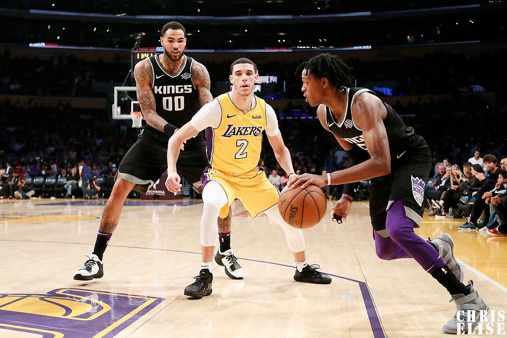09 January 2018: Sacramento Kings guard De'Aaron Fox (5) drives past Los Angeles Lakers guard Lonzo Ball (2) on a screen set by Sacramento Kings center Willie Cauley-Stein (00) during the LA Lakers 99-86 victory over the Sacramento Kings, at the Staples Center, Los Angeles, California, USA.