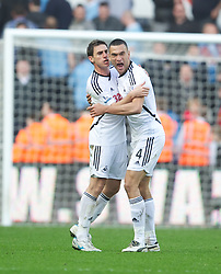 SWANSEA, WALES - Sunday, March 11, 2012: Swansea City's Steven Caulker celebrates after beating Manchester City 1-0 during the Premiership match at the Liberty Stadium. (Pic by David Rawcliffe/Propaganda)