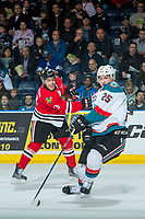 KELOWNA, CANADA - APRIL 8: Cal Foote #25 of the Kelowna Rockets attempts to block a shot by Caleb Jones #3 of the Portland Winterhawks on April 8, 2017 at Prospera Place in Kelowna, British Columbia, Canada.  (Photo by Marissa Baecker/Shoot the Breeze)  *** Local Caption ***