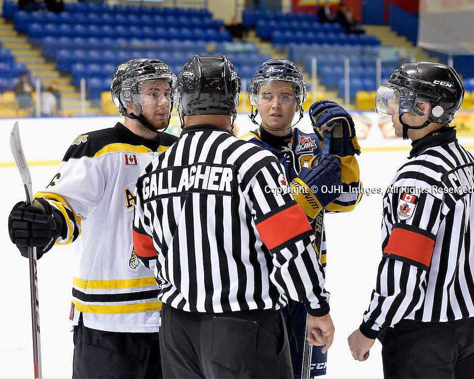 WHITBY, ON - Sep 20, 2015 : Ontario Junior Hockey League game action between Aurora and Whitby, OHA Referee Steve Gallagher explains the penalties to team captains Jordan Dasilva #16 of the Aurora Tigers and Jon O'Hara #15 of the Whitby Fury during the second period.<br /> (Photo by Shawn Muir / OJHL Images)