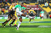 Highlanders' Waisake Naholo kicks the ball under pressure from Hurricanes' Beauden Barrett during the Round 14 Super Rugby match, Hurricanes v Highlanders at Westpac Stadium, Wellington. 27th May 2016. Copyright Photo.: Grant Down / www.photosport.nz