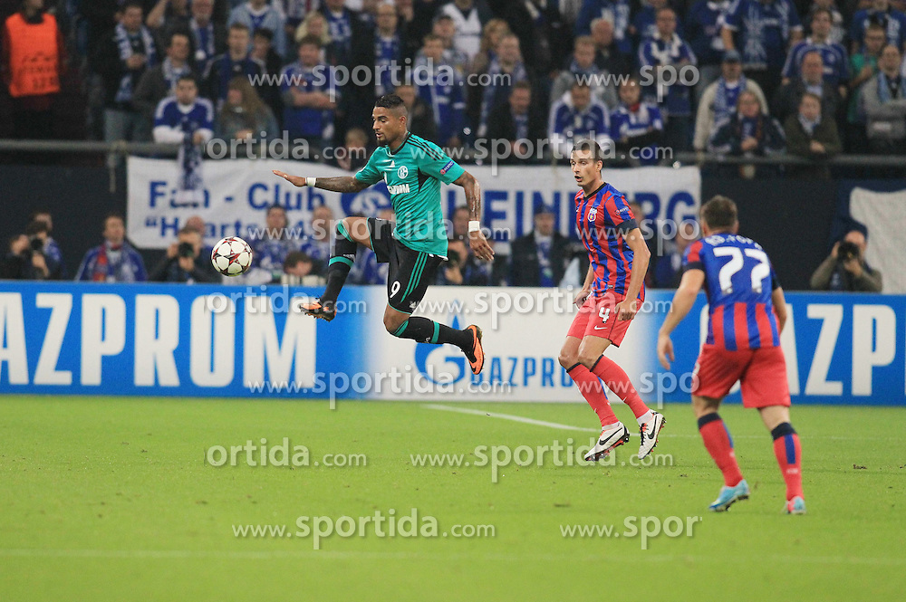 18.09.2013, Veltins Arena, Gelsenkirchen, GER, UEFA Champions League, Schalke 04 vs Steaua Bukarest, Gruppe E, im Bild Kevin-Prince Boateng #9 (FC Schalke 04) im Zweikampf gegen Lukasz Szukala #4 (Steaua Bukarest), Aktion, Action, //  during UEFA Champions League group E match between Schalke 04 vs Steaua Bukarest at the Veltlins Arena, Gelsenkirchen, Germany on 2013/09/18. EXPA Pictures &copy; 2013, PhotoCredit: EXPA/ Eibner/ Joerg Schueler<br /> <br /> ***** ATTENTION - OUT OF GER *****