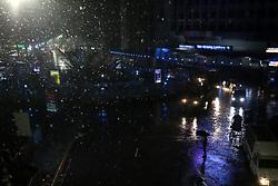 April 25, 2018 - Dhaka, Bangladesh - A man waits for public transport to return home during the rainfall at night in Dhaka, Bangladesh on April 25, 2018. (Credit Image: © Rehman Asad/NurPhoto via ZUMA Press)