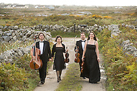 Galway Ensemble in Residence - ConTempo.On the way to the islands - - with Haydn & Mendelssohn!..The Galway Ensemble in Residence - Con Tempo, set off this morning for  Inis Oírr where they will begin their first ever County Galway tour, bringing the music of Haydn and Mendelssohn to the people of Galway in celebration of both composers whose bi-centenaries occurred this year. ..Pictured enroute to the Ferry at Rossaveal are:  Adrian Mantu, 'cello,   Ingrid Nicola, violin, Bogdan Sofei, violin and  Andreea Banciu, viola..The tour will continue over the weekend in various venues throughout the county before the grand finale in St. Nicholas Church with classical guitarist John Feeley on Sunday night. Photo : Andrew Downes. Photo issued with compliments, no reproduction fee...Tickets for all concerts will be available at the door. Check your local venue for more information or log on to www.galwayensemble.ie....