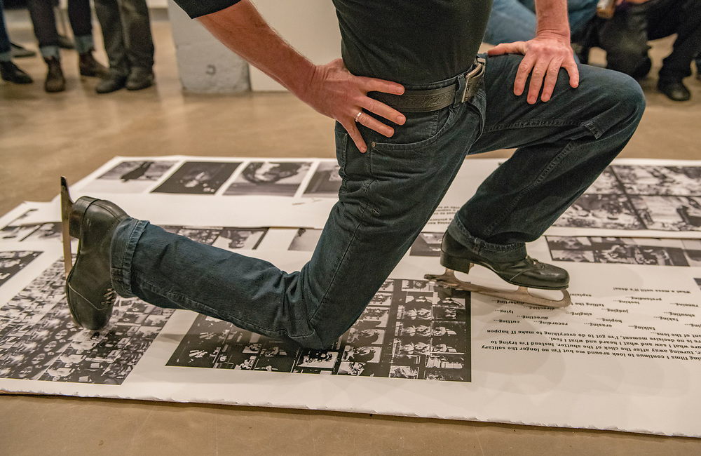 "Portland, Oregon, USA. 26 FEB, 2018. A performance artist shreds photographer Robert Frank's work with ice skates at Blue Sky Gallery in Portland, Oregon, USA. The work was destroyed in a ""Destruction Dance"" performance defacing the photographs with ink and mutilation with scissors, knives and even ice skates  at the end of it's run. The destruction was Frank's protest regarding today's greed in the global art market."