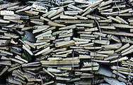 Piled up discarded keyboards lie in waiting in an area where much of the world's electronic-waste _ from cell phone chargers to mainframe computers _ ends up in Nanyang, Guiyu and other small towns like it in eastern China, Thursday March 16, 2006. Workers, many of them poorly paid migrants strip, smash and melt down circuit boards, mainly to extract the copper and other precious metals inside.The business has created massive pollution from leaded glass and other toxic materials. Such pollution could be mitigated by moves to recycle and properly dispose of so-called electronic waste that are gaining ground in the West. A European Union law requires manufacturers to recycle junk electronics free of charge, although policies in the United States are fragmented in different areas.