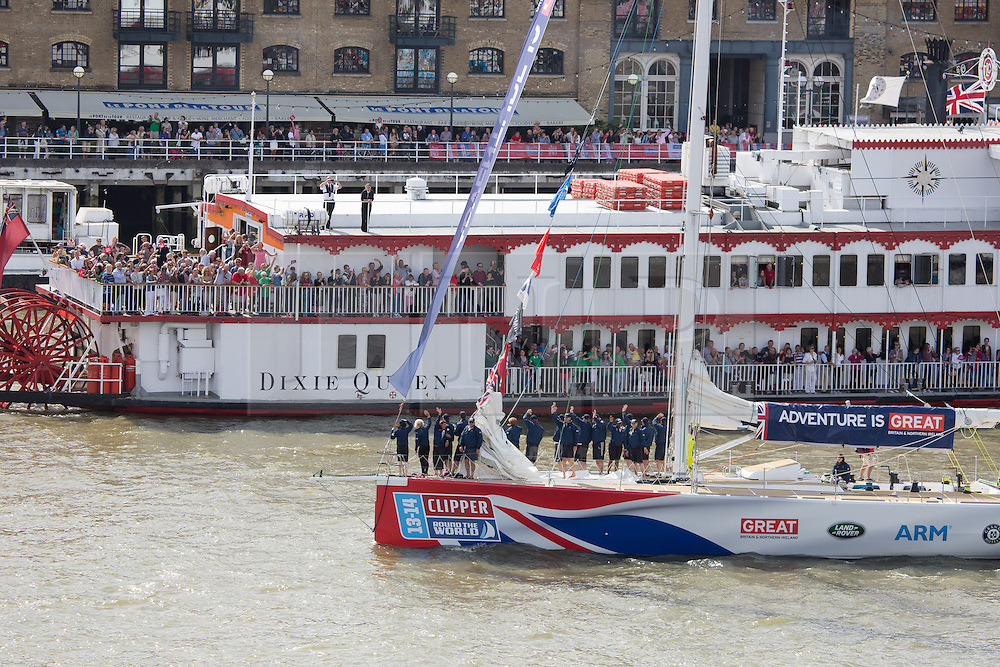 © Licensed to London News Pictures. 01/09/2013. London, UK. Crowds gather on passenger boats and line to banks of the River Thames for the departure of the Clipper 2013-14 Round the World Yacht Race. This is the first time London has hosted a round the world sailing race in more than 40 years.12 yachts ail begin the 40,000 mile, 11 leg race. They will visit six continents and the race will take 11 months to complete. 395 of the 670 crew members are from the UK, 87 come from London. Each vessel has an amateur crew under the command of a professional skipper. Photo credit : Vickie Flores/LNP