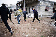 SYRIA - Homs province: Rebels run away from heavy shelling in Homs province on February 22, 2012. ALESSIO ROMENZI
