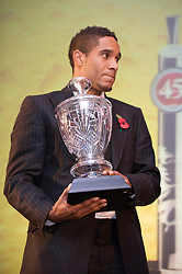 CARDIFF, WALES - Wednesday, November 11, 2009: Wales' Ashley Williams with the Welsh Player of the Year trophy during the Football Association of Wales Player of the Year Awards hosted by Brains SA at the Cardiff City Stadium. (Pic by David Rawcliffe/Propaganda)
