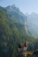 A young couple enjoys the view from Cascade Canyon in Grand Teton National Park, Jackson Hole, Wyoming.