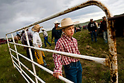 Raysha Warren looks on as ranchers rope calves to brand on the Higgins family ranch Wednesday, June 17. Photo by Lauren Justice