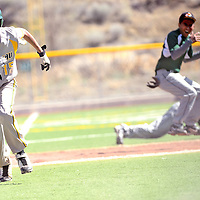 050213  Adron Gardner/Independent<br /> <br /> Thoreau Hawk Jim Largo (15), left, charges home to score after a Wingate Bear over throw to third base at Ford Canyon Park in Gallup Thursday.