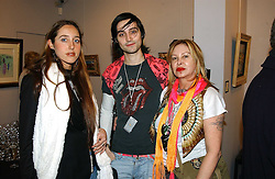 Left to right, MISS TATUM MAZZILLI, MR ROCKY MAZZILLI and MRS LOUISE MAZZILLI of the Voyage fashion store at the opening of an exhibition of paintings and watercolours by Raoul Dufy held at the Opera Gallery, 134 New Bond Street, London W1 on 6th February 2006.<br />