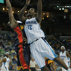 05 October 2008:  New Orleans Hornets center Hilton Armstrong (12) shoots over Golden State Warriors center Ronny Turiaf (21) during a NBA preseason game between the Golden State Warriors and the New Orleans Hornets at at the New Orleans Arena in New Orleans, LA..