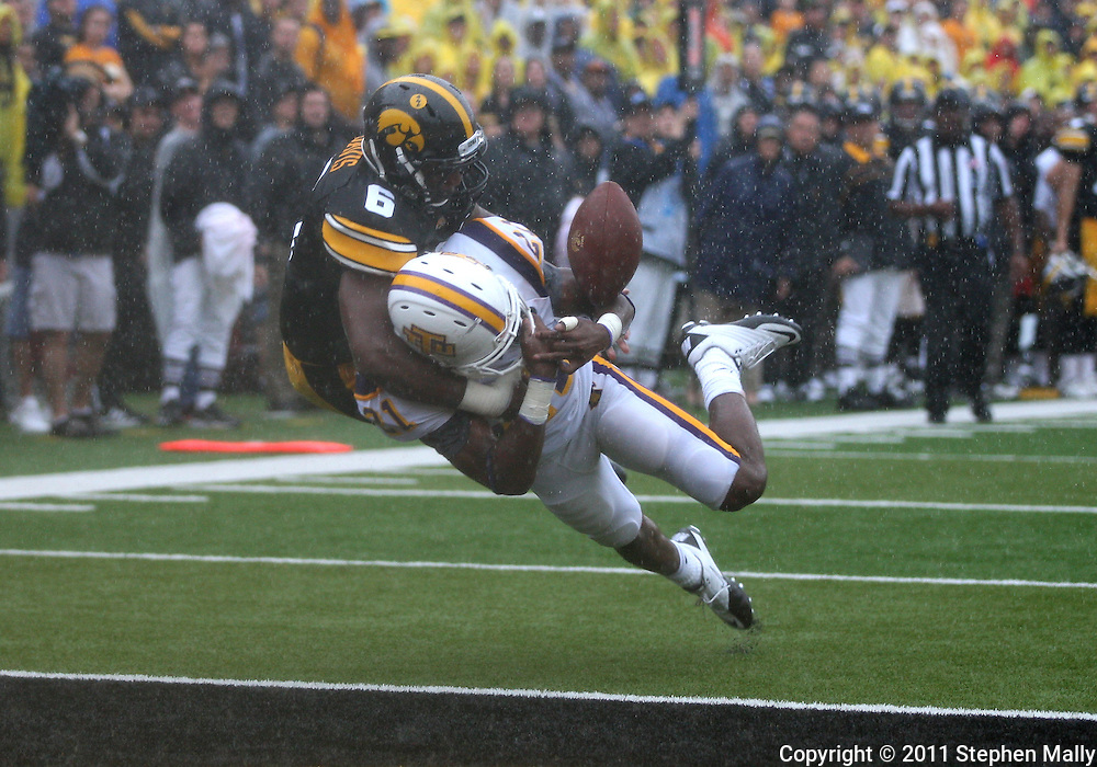 September 3, 2011: Iowa Hawkeyes wide receiver Keenan Davis (6) can't pull in a pass as Tennessee Tech Golden Eagles cornerback Richmond Tooley (21) defends during the first half of the game between the Tennessee Tech Golden Eagles and the Iowa Hawkeyes at Kinnick Stadium in Iowa City, Iowa on Saturday, September 3, 2011. Iowa defeated Tennessee Tech 34-7 in a game stopped at one point due to lightning and rain.