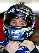NASCAR Sprint Cup Series auto racing driver Jimmy Johnson gets ready for a practice run at Kansas Speedway in Kansas City, Kan., Saturday, Oct. 16, 2015. (AP Photo/Colin E. Braley)
