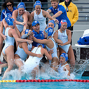 /Andrew Foulk/ For The Californian/ .Members of the Temescal Canyon girls water polo team jump into the pool with their coach Damien Andrew's after their 11-10 overtime victory over Bonita during the CIF Southern Section Division V girls water polo championship match.