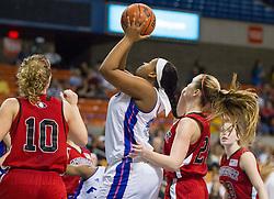 Fairmont Senior center Summer West (44) shoots under the basket against Bridgeport during a first round game at the Charleston Civic Center.
