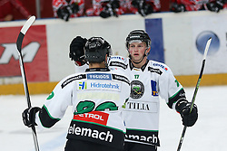 Fabian Scholz and Miha Logar of Olimpija during ice hockey match between HDD SIJ Acroni Jesenice and HDD Telemach Olimpija, on August 29 in Dvorana Podmezaklja, Jesenice, Slovenia. Photo by Matic Klansek Velej / Sportida