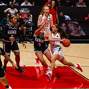 09 November 2018:  San Diego State Aztecs guard Sophia Ramos (2) drives the ball into the key while being defended by Hawaii Warriors guard Savannah Reier (4) in the third quarter. The Aztecs opened up it's regular season schedule with a 58-57 win over Hawaii Friday at Viejas Arena.