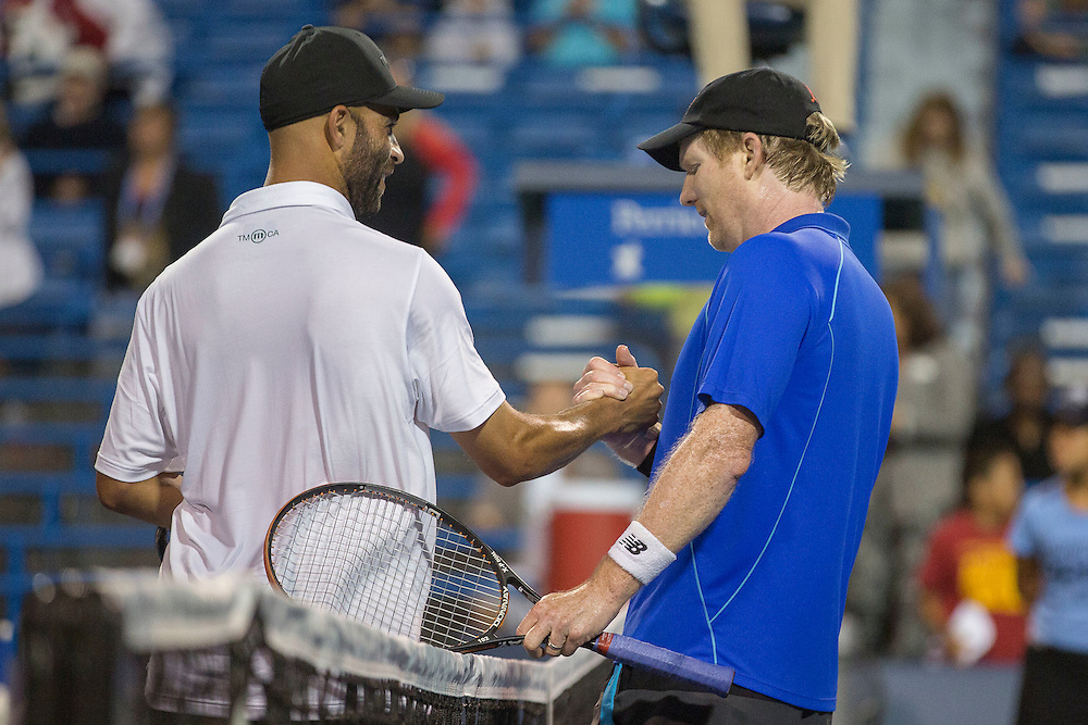 August 20, 2014, New Haven, CT:<br /> James Blake and Jim Courier shake hands at net after playing each other during the Men's Legends Event on day six of the 2014 Connecticut Open at the Yale University Tennis Center in New Haven, Connecticut Wednesday, August 20, 2014.<br /> (Photo by Billie Weiss/Connecticut Open)