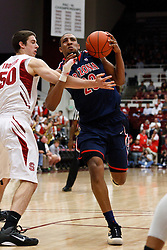 February 3, 2011; Stanford, CA, USA;  Arizona Wildcats forward Derrick Williams (23) is fouled by Stanford Cardinal forward/center Jack Trotter (50) during the first half at Maples Pavilion.