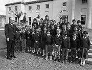 President Hillery Meets Schoolchildren at The Arás.(R59)..1987..15.06.1987..06.15.1987..15th June 1987..As part of an educational tour pupils from Scoil Barra, Ballincollig, Cork were treated to a tour of Arás on Uachtaráin. The pupils were very lucky as the president himself,Dr Hillery, pointed out the highlights of the Arás. With the party was the class teacher Ms Orla Murphy...Picture shows President Hillery pointing out some of the highlights of both the Arás and the Phoenix Park to the children from Ballincollig.